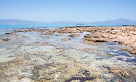Pictorial background of turquoise sea and rocky beach, Chrissi Island, Crete, Greece Stock Images
