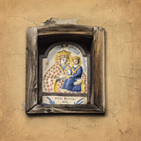 Pictorial ceramic tile. Image of a pictorial ceramic tile inside a building niche. Bologgna, Italy Stock Photography