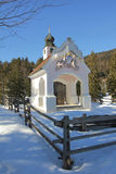 Pictorial chapel in wintry landscape Stock Photos