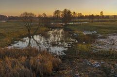 Evening landscape with Syrovatka river at sunset time, Sumskaya oblast,  Ukraine Royalty Free Stock Photo