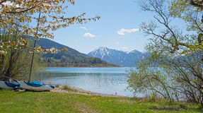 Pictorial lake tegernsee in april, lake shore with catamaran and Royalty Free Stock Photos