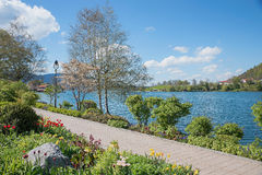 Pictorial lakeside tegernsee with amelanchier tree and lantern Stock Images