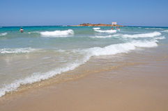 Pictorial landscape of beautiful Malia beach, Crete, Greece. With white see waves and sandy shore Stock Photos