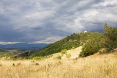 A pictorial landscape in Serbia. A pictorial landscape near the Djurdjevi Stupovi Monastery in Serbia. The monastery is seen on top of the hill stock photography