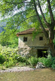 Pictorial landscape of an old water mill, Serbia. Pictorial summer landscape of an old, country water mill, Serbia. It is built on a small mountain stream Royalty Free Stock Images