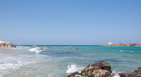 Pictorial landscape of sandy, wavy beach at Crete Island Stock Image