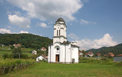 Pictorial landscape of white, country Orthodox church, Serbia Stock Image