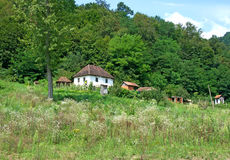 Pictorial, lonely mountain farm, Serbia. Pictorial summer landscape of the lonely farm with white house in mountain woods, Serbia. The house was built in the old Royalty Free Stock Photo
