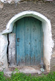 Pictorial old, blue cottage door. Pictorial background with blue door of the old, cottage, village house Royalty Free Stock Photography