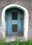 Pictorial old cottage door. Pictorial background with blue door of the old, cottage, village house Stock Photo