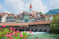 Pictorial old town thun and wooden dam bridge over aare river, s Royalty Free Stock Images