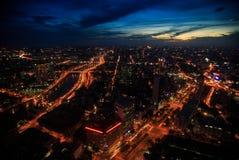 Night City Panorama with River Embankment Saigon Vietnam. Pictorial panorama of large night city with brightly lit river embankments under dramatic dark blue sky royalty free stock image