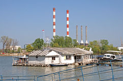 Pictorial rafts and cottages opposite of thermo plant Stock Photos