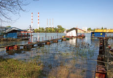 Pictorial rafts, cottages and thermo power station at the river Sava in Belgrade Royalty Free Stock Photography