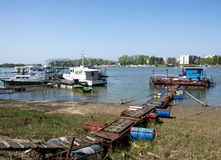 Pictorial rafts opposite the city on the river Sava in Belgrade. Landscape of rafts, cottages, thermo power station and heating plant at the river Sava in stock images