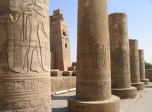 Pictorial reliefs on columns of Kom Ombo Temple, Egypt. Carved and painted pictorial reliefs on columns at Temple of Sobek and Horus at Kom Ombo, Egypt Royalty Free Stock Photography