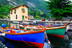 Pictorial scenery with boats in beautiful lake Lago di Garda. To Stock Photo