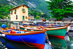 Pictorial scenery with boats in beautiful lake Lago di Garda. To Royalty Free Stock Photos