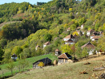 Pictorial sunny autumn landscape of a small mountain village Stock Photo