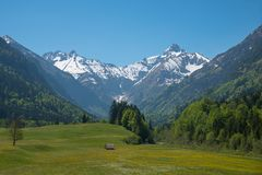 Pictorial trettach valley and snowy mountains, allgau alps at springtime royalty free stock photo