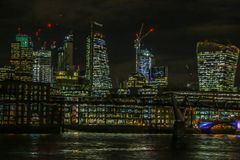 Pictorial view with London skyscrapers in the night. Glass filter applied Royalty Free Stock Image