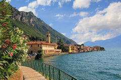 Pictorial village gargnano, lago die garda. Pictorial village gargnano, lago di garda, lakeside promenade with oleander and church Stock Photography