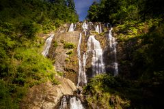 Pictorial Waterfall on Rocks between Tropical Jungle Stock Photography