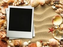 Picture frame on shells and sand background Stock Images