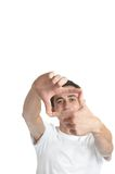 Picture this 2. Young man over white background / focus on the hands Royalty Free Stock Photo