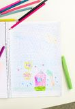Picture. Portrait of lovely girl drawing with pencil in copybook royalty free stock image