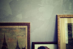 Picture. Old paintings facing the wall in a row Royalty Free Stock Image