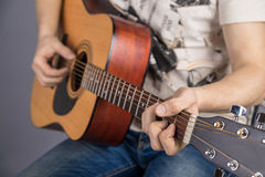 A picture of an acoustic guitar, classical color, in the hands of a guitarist Stock Photography