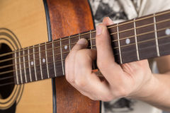A picture of an acoustic guitar, classical color, in the hands of a guitarist Stock Image