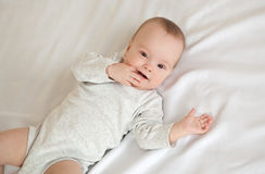 Picture of adorable baby lying on bed Royalty Free Stock Image