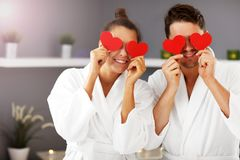 Adult happy couple relaxing in spa salon royalty free stock photography