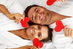Adult happy couple relaxing in spa salon stock images