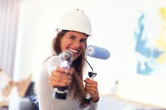 Mature woman doing home improvements stock photo