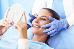 Adult woman having a visit at the dentist`s royalty free stock image