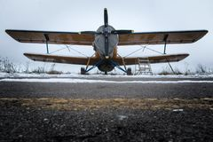 Old biplane is standing on the runway Royalty Free Stock Image