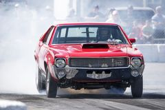 Amx drag car. Picture of amx javelin making a smoke show at starting line on the track during the john scotti all out august 17, 2017 Royalty Free Stock Image