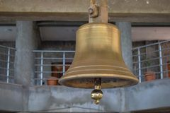 Ancient epic copper bell hanging in the temple royalty free stock photography