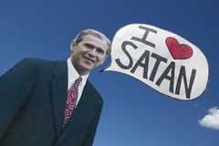 Picture of anti-Bush political rally in Tucson, AZ with a sign saying President George W. Bush Loves Satan in Tucson, AZ Stock Image