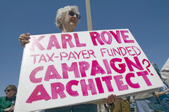 Picture of anti-Bush political rally in Tucson, AZ with signs about Karl Rove in Tucson, AZ Stock Image