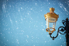 Picture of an antique street lamp against blue sky. vintage filtered image and bokeh light Stock Photography