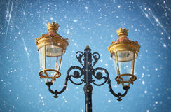 Picture of an antique street lamp against blue sky. vintage filtered image and bokeh light Stock Image