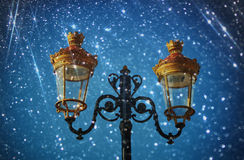 Picture of an antique street lamp against night  sky. vintage filtered image and bokeh light Stock Images