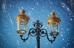 Picture of an antique street lamp against night sky. vintage filtered image and bokeh lights Royalty Free Stock Photos