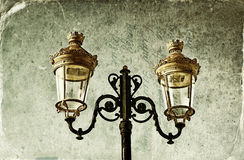 Picture of an antique street lamp with vintage style texture overlaid effect Stock Photos