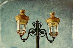 Picture of an antique street lamp with vintage style texture overlaid effect Stock Images