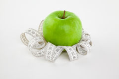 Picture of apple and tape measure Stock Photography